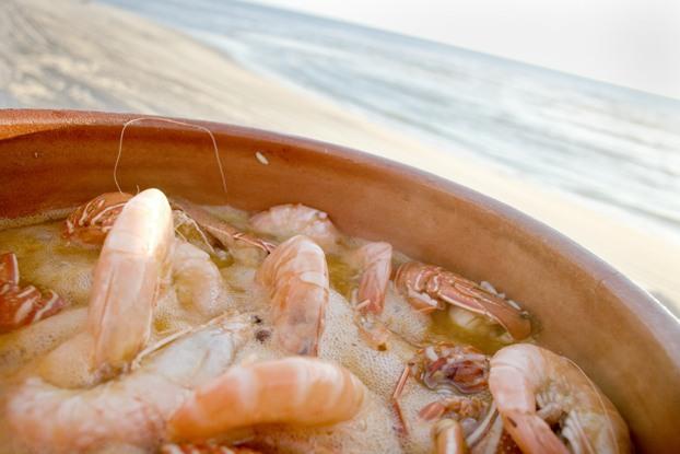 Lagostas e santolas numa praia a desaparecer: Arroz de Marisco