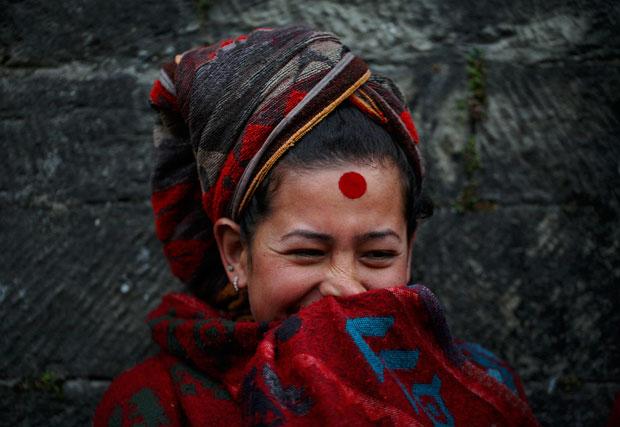 NEPAL. 23.01.2012. Um sorriso perto do templo de Pashupatinath, Katmandú.