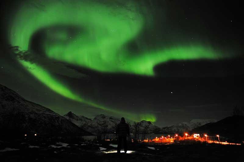 Aurora boreal vista a 25 de Janeiro de 2012 em Tromsoe, Noruega