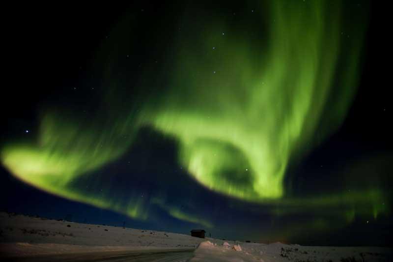 Aurora Boreal em Finnmark, Noruega (13.03.2011). Foi fotografada durante a mais setentrional   das corridas de trenós de cães do mundo. Foi uma das fotos AFP do ano em 2011.