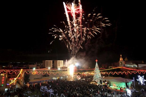 Celebrações palestinianas na iluminação da árvore de Natal perto da Igreja da Natividade, Belém, Cisjordânia