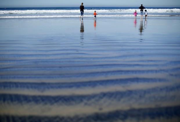 EUA, 8.1.2013. A brincar na praia em La Jolla, Califórnia