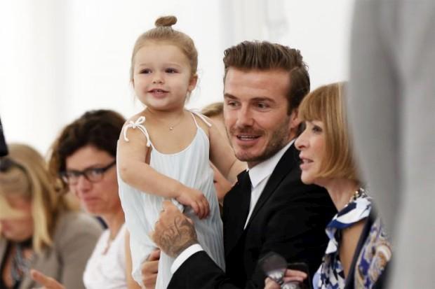 David Beckham com a filha, Harper, e a directora da Vogue norte-americana Anna Wintour
