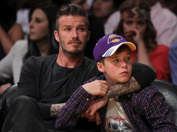 David Beckham com um dos filhos, Brooklyn