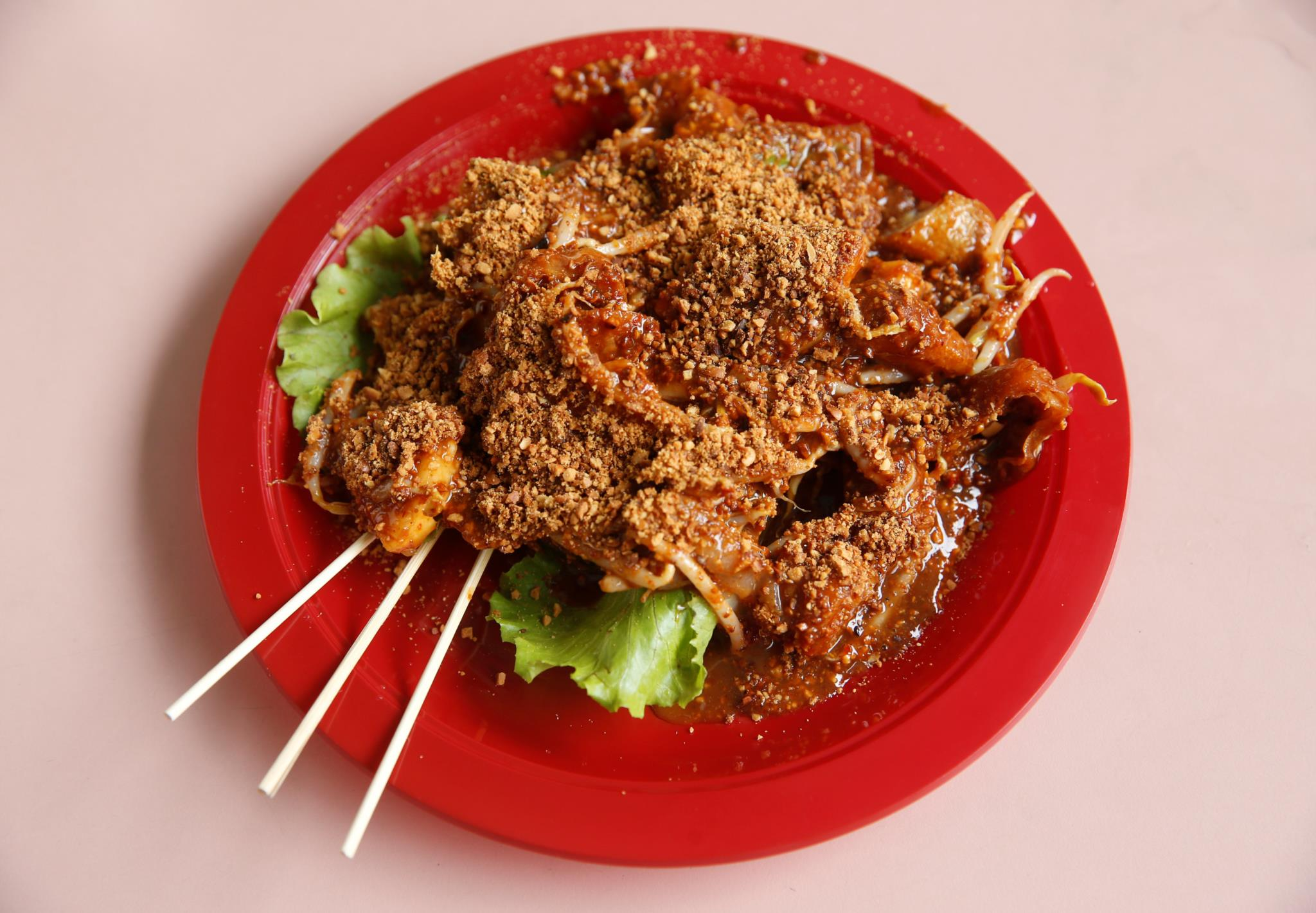 A especialidade do restaurante de Stan Lim, que recebeu o prémio internacional Michelin Bib Gourmand, é <i>rojak</i>, uma salada com fruta e legumes