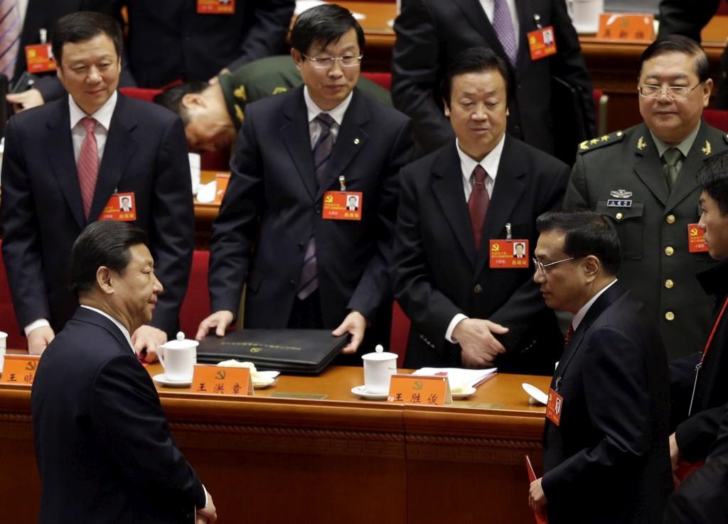 Em primeiro plano, os próximos Presidente, Xi Jinping, e primeiro-ministro,  Li Keqiang